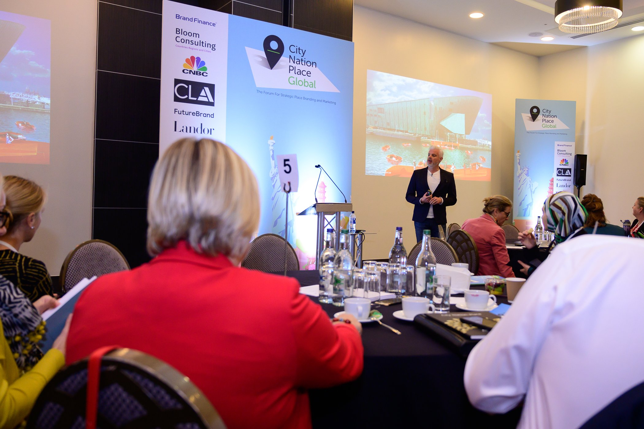 Photo of Jon Tipple from Future Brand presenting at their Breakfast Briefing at City Nation Place Global 2019