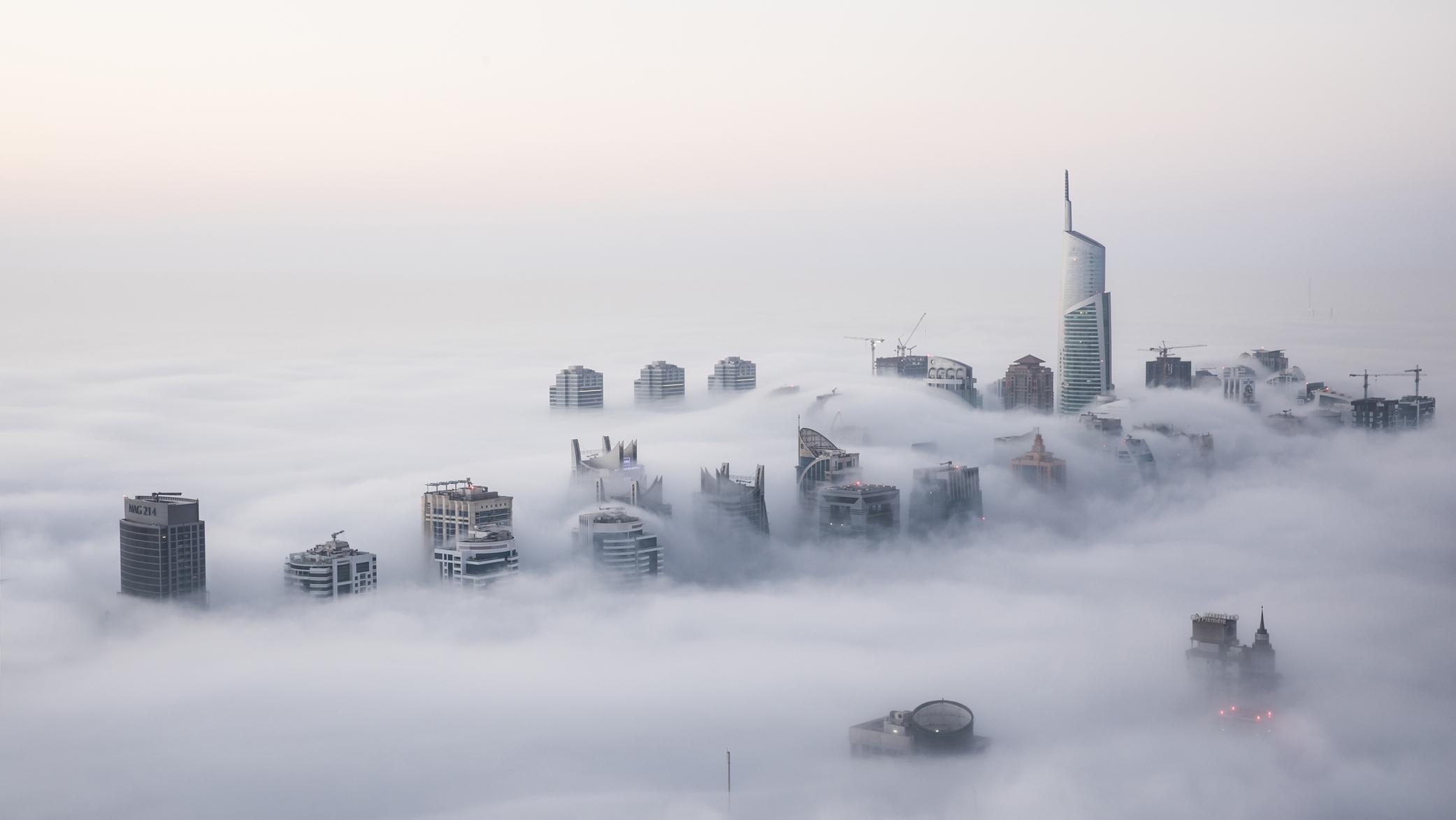Aerial photo of Dubai in clouds