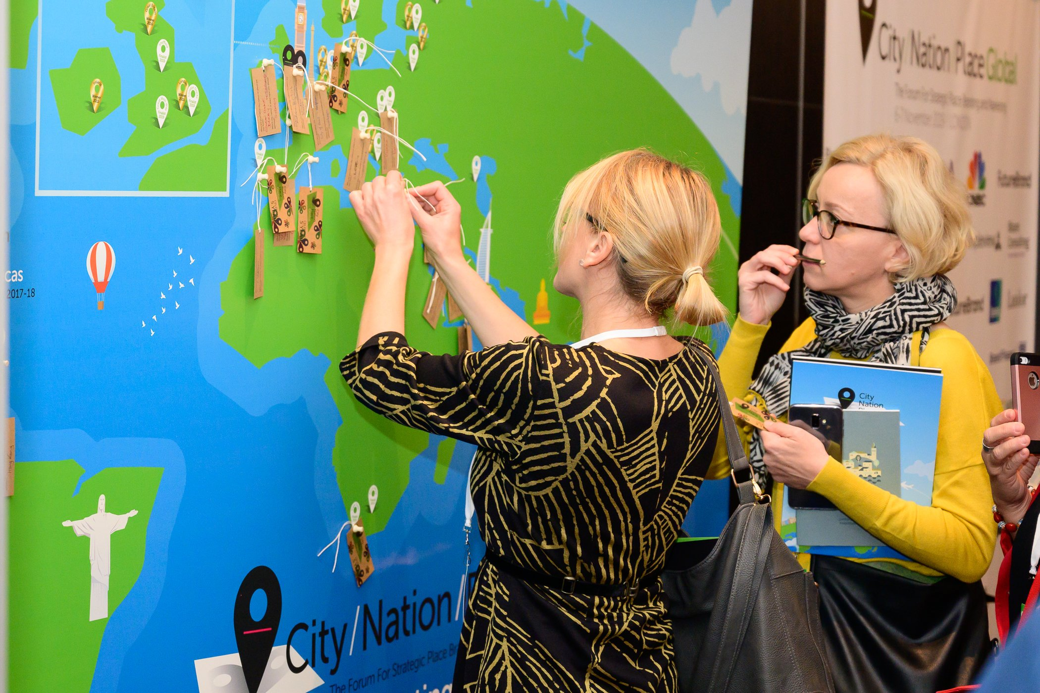 Two delegates put a pin in the world map at CNP Global