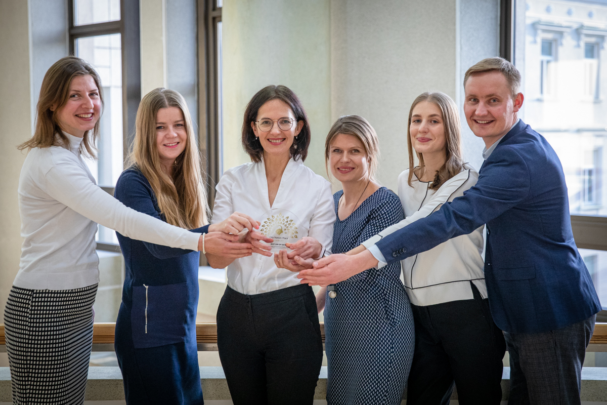 The Lithuania team celebrate with the award for Best Use of Data