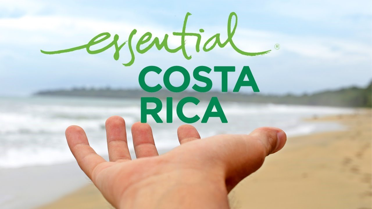 essential Costa Rica logo in front of beach.